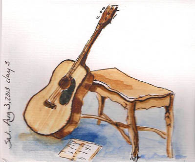 My guitar waiting patiently for me to stop sketching and play.